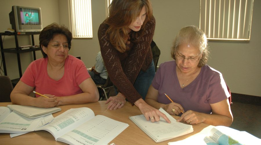Adult Basic Education teacher working with 2 adult learners