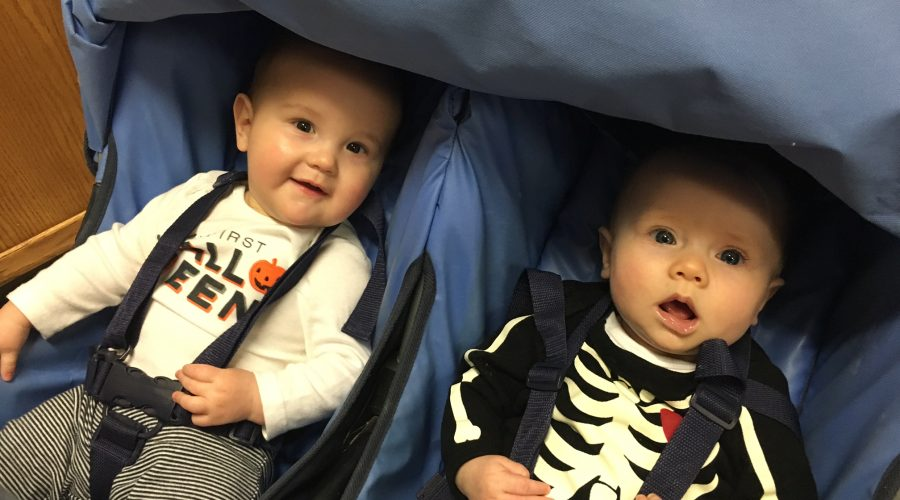 Earlyventures babies in Halloween costumes in a stroller
