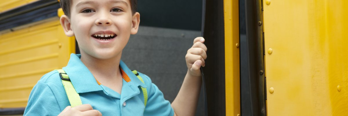 Elementary School Student Boards Bus