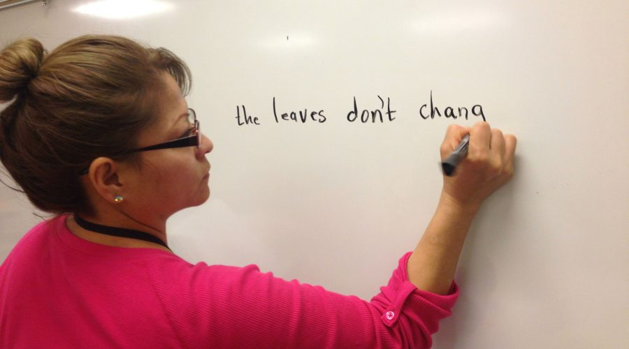 Adult Basic Education learner writing on the white board