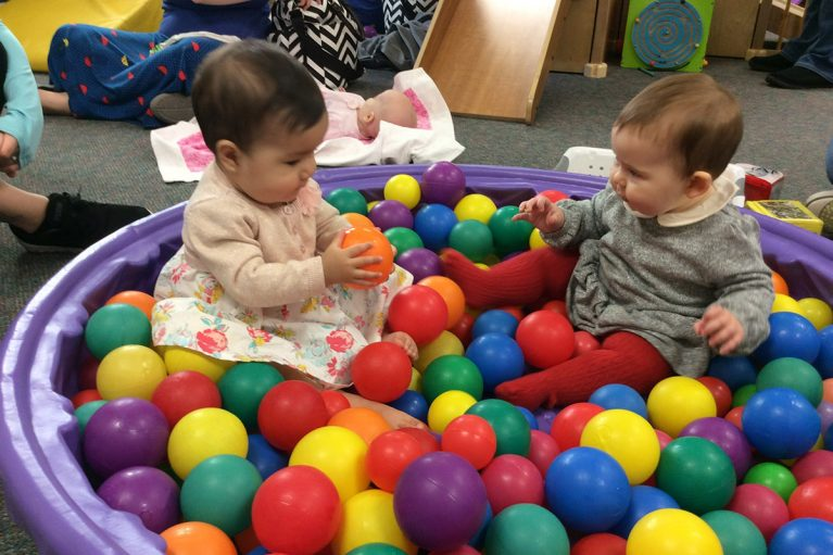 Babies playing in ball pit