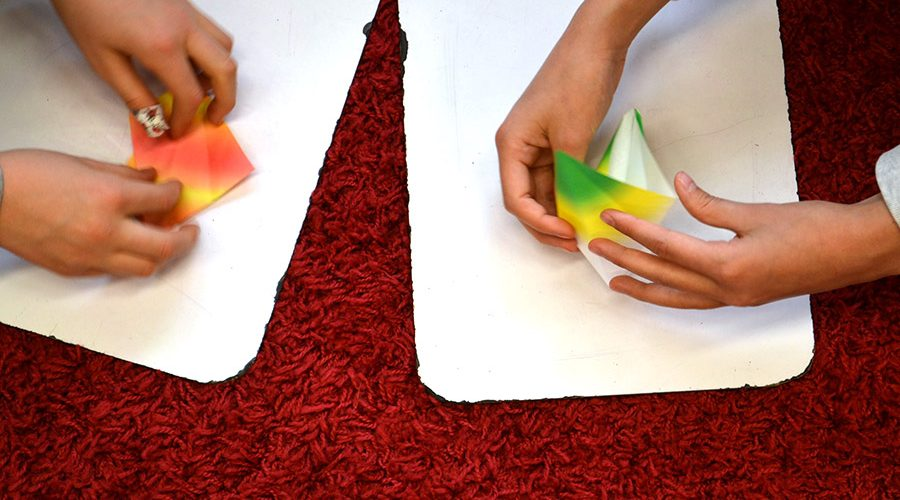 Hands Making Origami