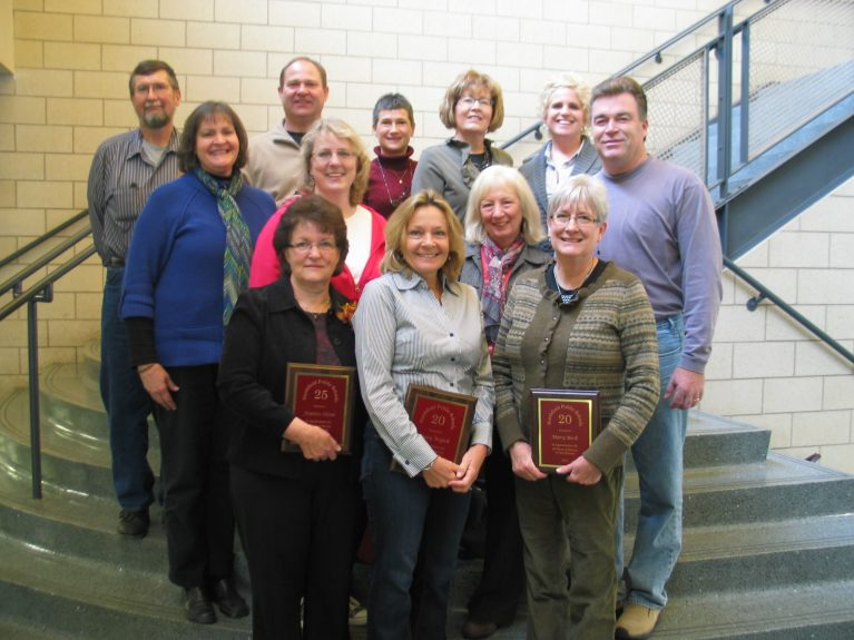 A group of teachers receive the Years of Service award
