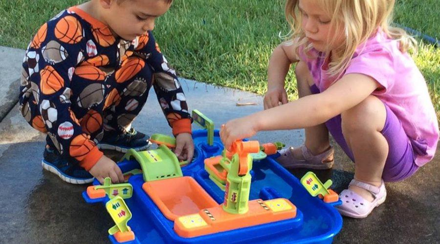 2 pre-school kids playing outside