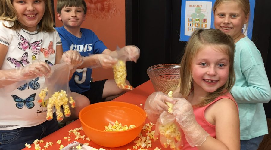 KidVentures after school care group of kids making a popcorn craft