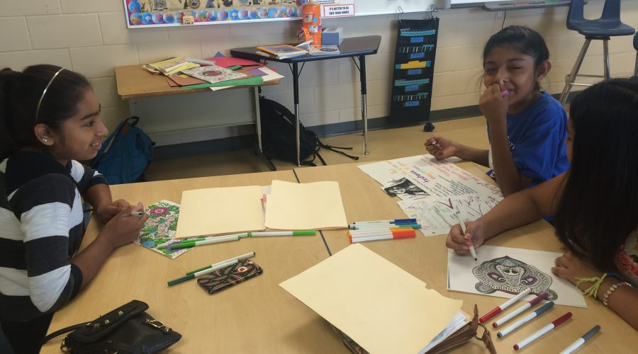 girls coloring pages in MSYC classroom