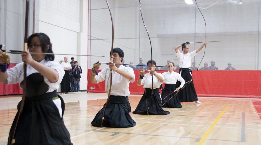 Participants show form in Kyudo class